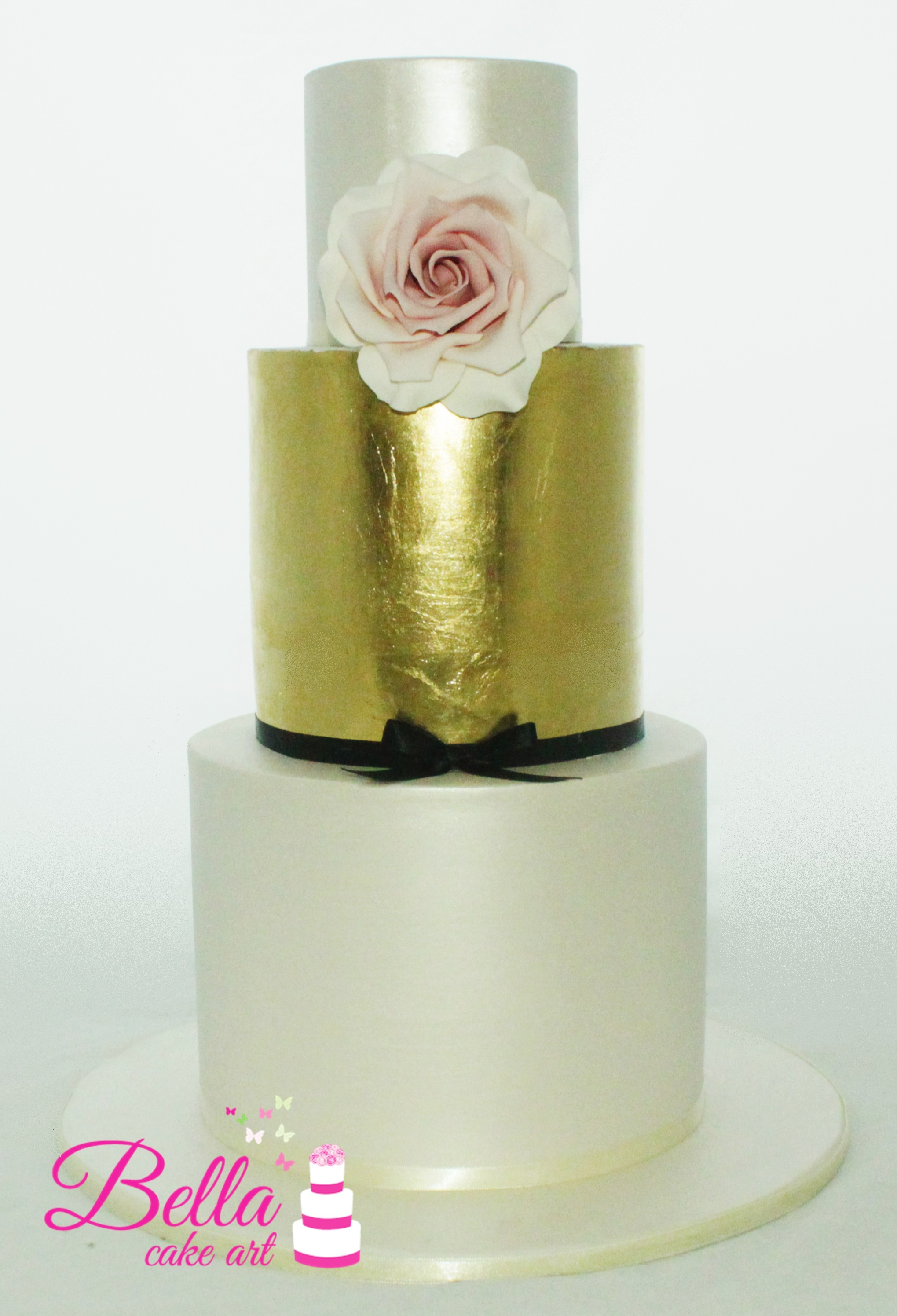 Three Tier Wedding Cake with gold leaf and a handmade flower