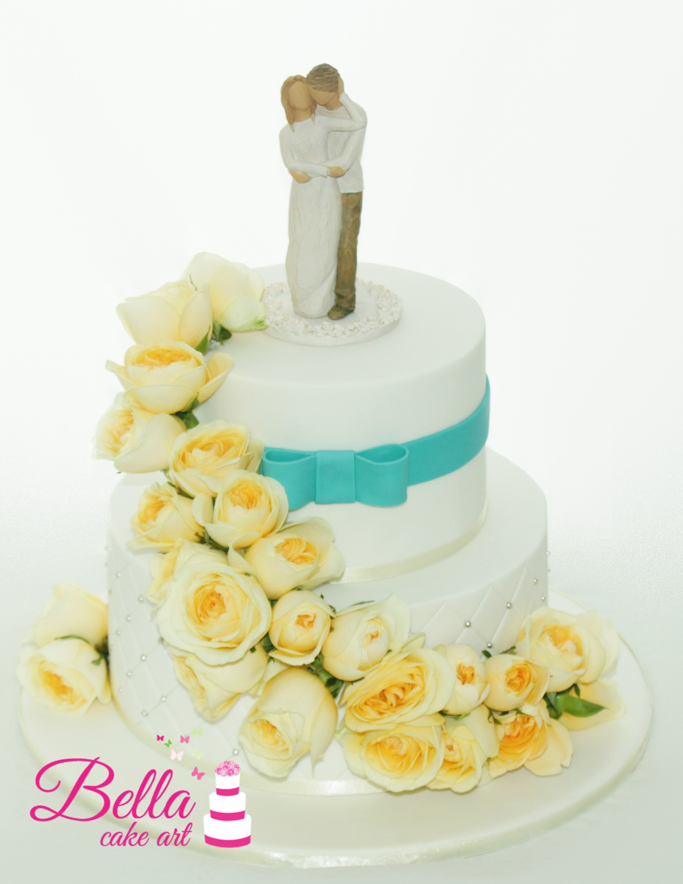 Two Tier quilted cake with bow and fresh flowers